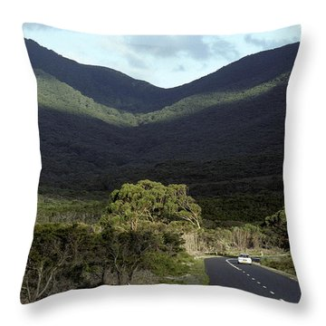 A Lone Vehicle Meanders Along A Throw Pillow