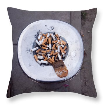A Lot Of Cigarettes Stubbed Out At A Garbage Bin Throw Pillow