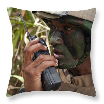 A Malaysian Paratrooper Maintains Throw Pillow by Stocktrek Images