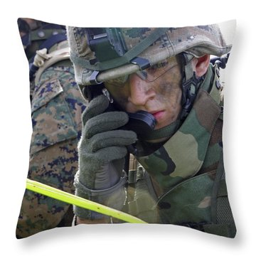 A Marine Communicates Over The Radio Throw Pillow by Stocktrek Images