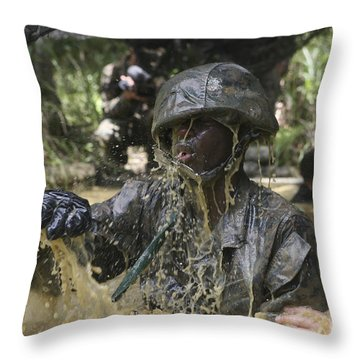 A Marine Splashes As He Makes His Way Throw Pillow by Stocktrek Images