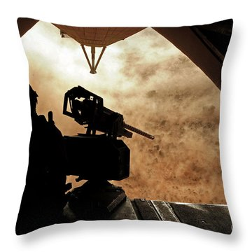 A Marine Waits For Dust To Clear While Throw Pillow by Stocktrek Images