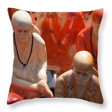 Throw Pillow featuring the photograph A Number Of Statues Of The Shirdi Sai Baba For Sale At Surajkund Mela by Ashish Agarwal