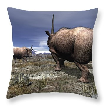 A Pair Of Male Elasmotherium Confront Throw Pillow by Walter Myers