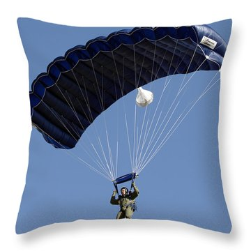 A Paratrooper Descends Through The Sky Throw Pillow by Stocktrek Images
