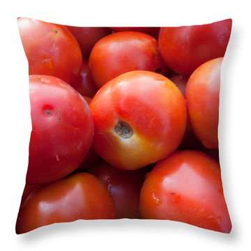 A Pile Of Luscious Bright Red Tomatoes Throw Pillow by Ashish Agarwal