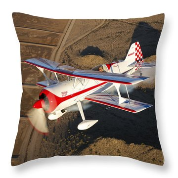 A Pitts Model 12 Aircraft In Flight Throw Pillow by Scott Germain