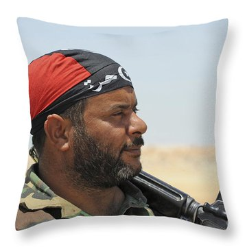 A Rebel Fighter Armed With A Fn Fal Throw Pillow by Andrew Chittock