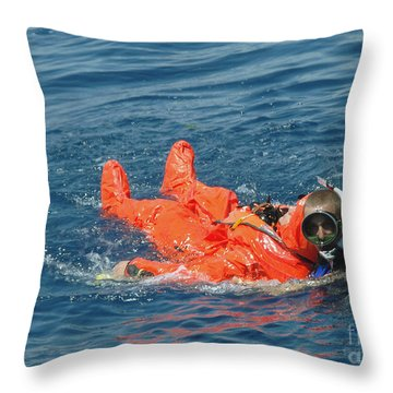 A Sailor Rescued By A Diver Throw Pillow by Stocktrek Images