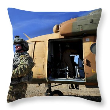 A Security Forces Airman Covers Throw Pillow
