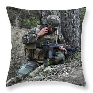A Soldier Communicates His Position Throw Pillow by Stocktrek Images