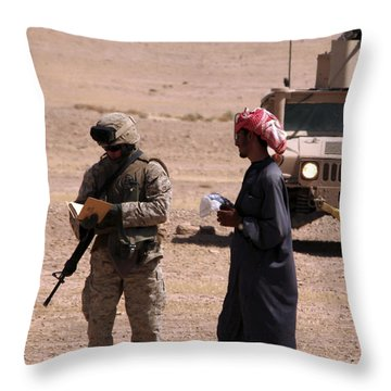 A Soldier Communicates With A Local Throw Pillow by Stocktrek Images
