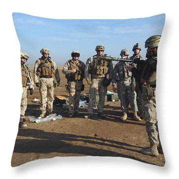 A Soldier Teaches How To Properly Throw Pillow by Stocktrek Images