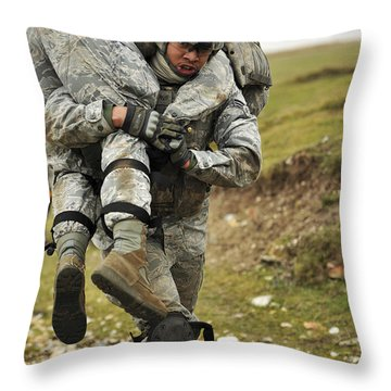 A Soldier Transports A Fellow Wounded Throw Pillow by Stocktrek Images