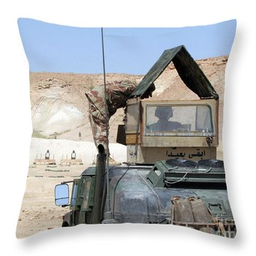 A Soldiier Instructs An Iraqi Army Throw Pillow by Stocktrek Images