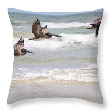 A Squadron Of Brown Pelicans Throw Pillow by Roena King