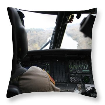 A Uh-60 Blackhawk Flies The River To An Throw Pillow by Terry Moore