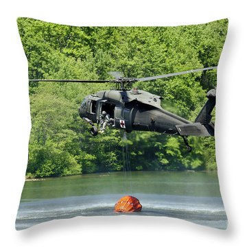 A Uh-60 Blackhawk Helicopter Fills Throw Pillow by Stocktrek Images