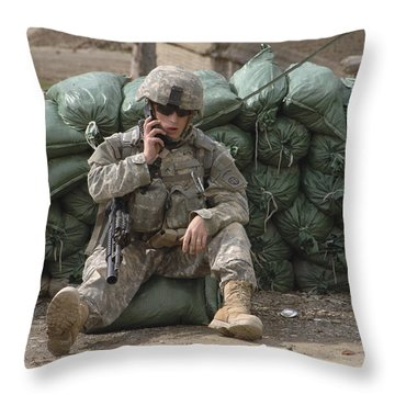 A U.s. Army Soldier Talks On A Radio Throw Pillow by Stocktrek Images