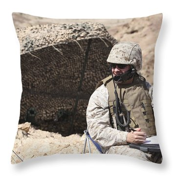 A U.s. Marine Communicates With Close Throw Pillow by Stocktrek Images