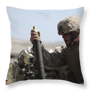 A U.s. Marine Loads A Mortar Throw Pillow by Stocktrek Images