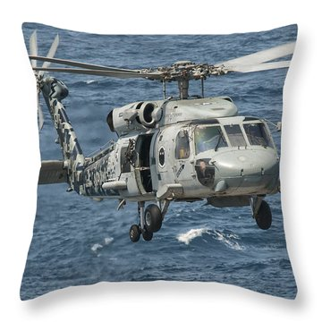 A Us Navy Sh-60f Seahawk Flying Throw Pillow by Giovanni Colla