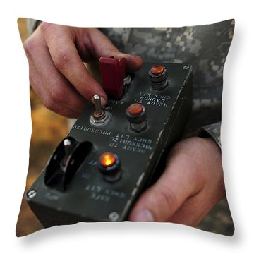 A U.s. Soldier Hits The Button Throw Pillow by Stocktrek Images