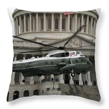 A Vh-60 Helicopter Lands In Front Throw Pillow by Stocktrek Images