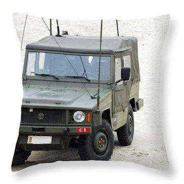 A Vw Iltis Jeep Of A Unit Of Belgian Throw Pillow by Luc De Jaeger