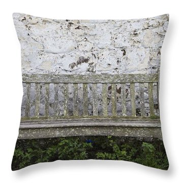 A Wooden Bench With Peeling Paint Throw Pillow by John Short