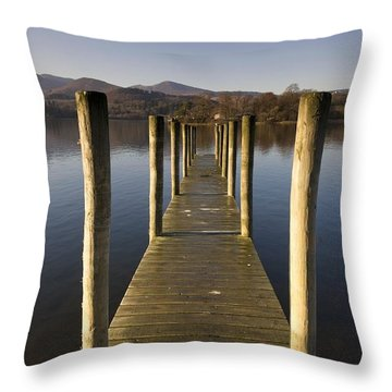 A Wooden Dock Going Into The Lake Throw Pillow by John Short