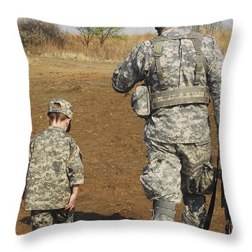 A Young Boy Joins His Squad Leader Throw Pillow by Stocktrek Images