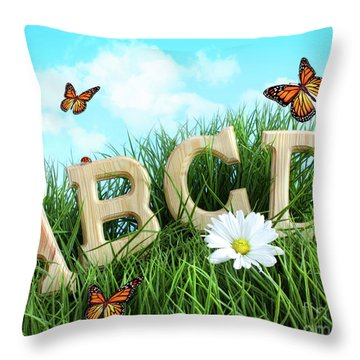 Abc Letters With Daisy In Grass Throw Pillow by Sandra Cunningham