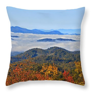 Above The Clouds Throw Pillow by Susan Leggett