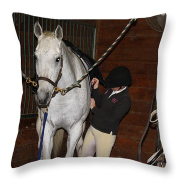 Adjusting The Girth Throw Pillow by Roena King