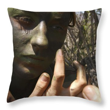 Airman Applies Camouflage Paint Throw Pillow by Stocktrek Images