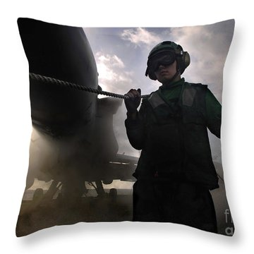 Airman Holds Up The Safety Shot Line Throw Pillow by Stocktrek Images
