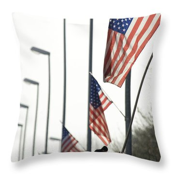 Airman Posts A New Flag On The Main Throw Pillow by Stocktrek Images