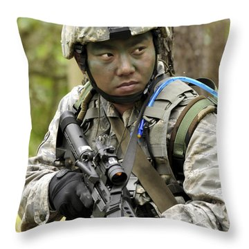 Airman Scans The Tree Line For Enemy Throw Pillow by Stocktrek Images