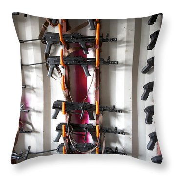 Akm Assault Rifles Lined Up On The Wall Throw Pillow by Terry Moore