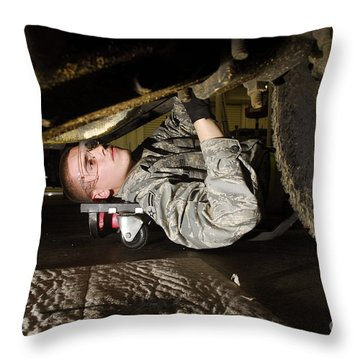 An Airman Inspects The Undercarriage Throw Pillow by Stocktrek Images