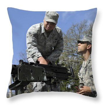 An Airman Instructs A Cadet On How Throw Pillow by Stocktrek Images
