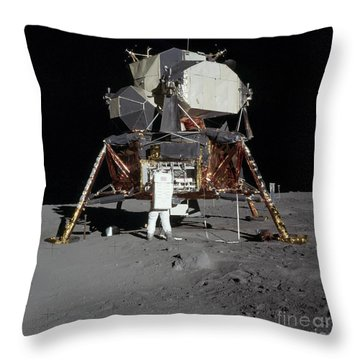 An Apollo 11 Astronaut In Front Throw Pillow by Stocktrek Images