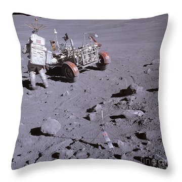 An Astronaut And A Lunar Roving Vehicle Throw Pillow by Stocktrek Images