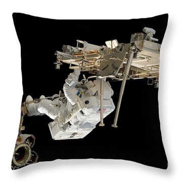 An Astronaut With His Feet Secured Throw Pillow by Stocktrek Images