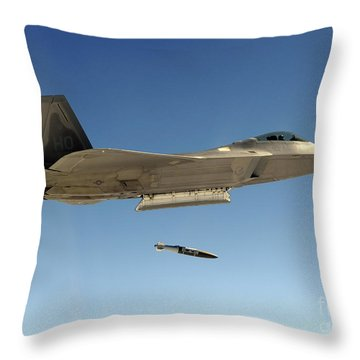 An F-22a Raptor Drops A Gbu-32 Bomb Throw Pillow by Stocktrek Images