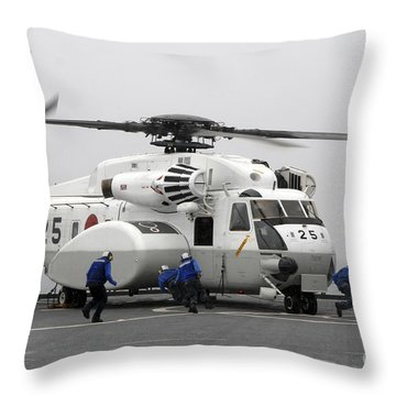 An Mh-53e Super Stallion Helicopter Throw Pillow by Stocktrek Images