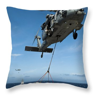 An Mh-60s Sea Hawk Helicopter Lowers Throw Pillow by Stocktrek Images