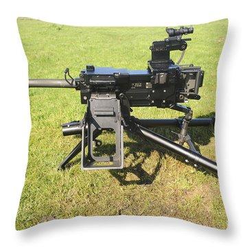 An Mk19 40mm Machine Gun Throw Pillow by Andrew Chittock