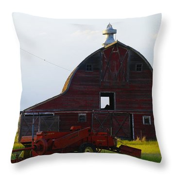 an old barn and bailor in Eastern Montana Throw Pillow by Jeff Swan